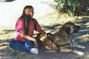 [ Aslan with Janice, relaxing in the shade. ]